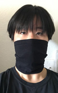 Stacey Thai wearing a face mask she made from an old t-shirt, front view cropped 120 pixels