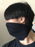 Stacey Thai wearing a face mask she made from an old t-shirt,side view 120 pixels