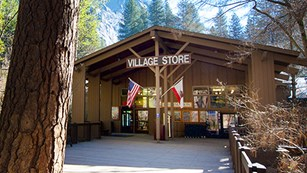 front entrance with large sign Village Store