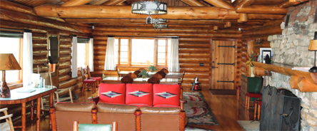cabin with log walls and western furnishings