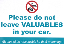 sign that says please do not leave valuables in your car