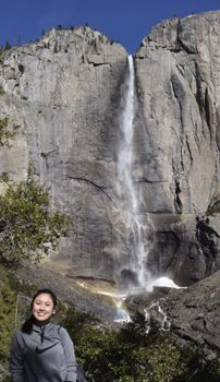 woman in foreground, Yosemite fall behind