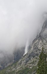 thick clouds above waterfall