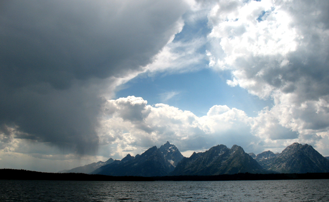 Teton peaks with clouds and rain falling