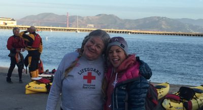 two women with Aquatic park bay in the background