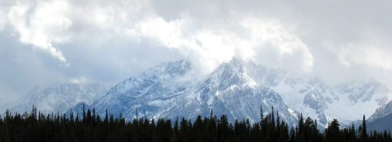 Grand teton peaks with heavy clouds above