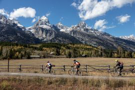 bikes on pathway with Teton peaks in background