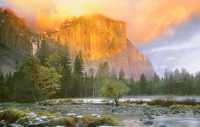 El Capitan bathed in sunset light, rivet in foreground