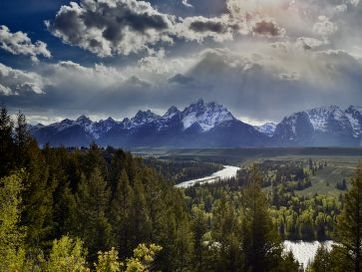 clouds, mountains and forested river