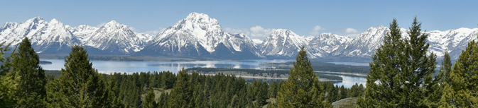 snow covered mountains and lake