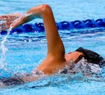 arm high out of water on freestyle recovery