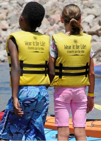 2 children wearing lifejackets