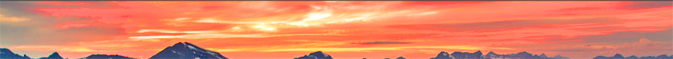 bright sunset clouds and tops of peaks