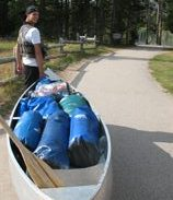 man, canoe and wide paved path