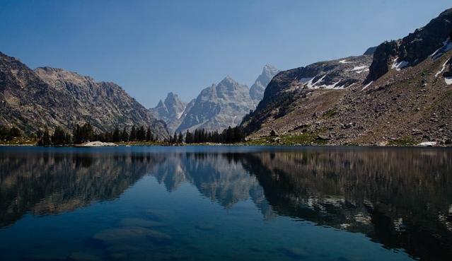 large lake with peaks behind