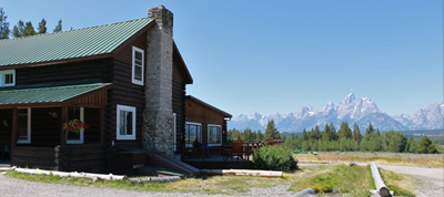 building with Teton range in background