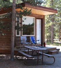 small cabin and picnic table