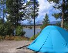 tent in foreground, lake behind