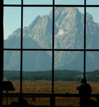 huge window with mountain seen thru it