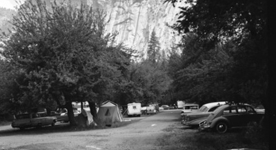 cars, tents in parking lot