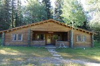 log cabin with big covered front porch