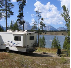 motor home and lake behind it