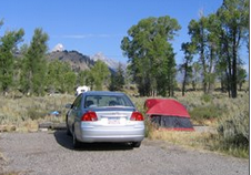 car and tent in campsite