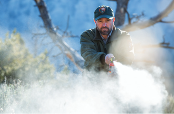 ranger spraying bear spray
