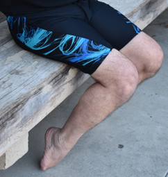 sitting on bench stretching ankles