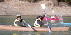 kayakers almost paddling simultaineously