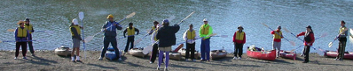 line of people with paddles in motion