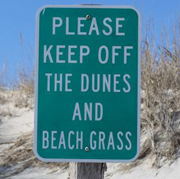 sign says please keep off the dunes and beach grass