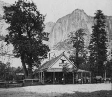 Cosmopolitan Bath House  building with Yosemite Falls in distance behind