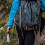 hiker with bear spray in their hand