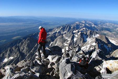 climber standing near top of peak