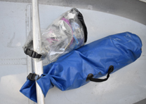 dry bags clipped to a boat thwart