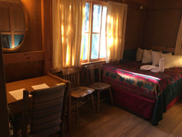 Colter Bay cabin interior with desk and wall mirror