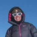 woman wearing hooded jacket and sunglasses