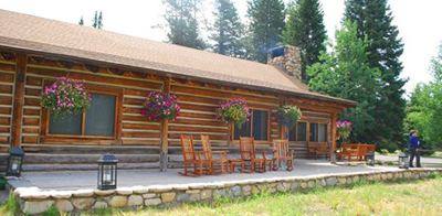 cabin-like building with hanging flower baskets