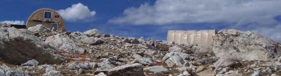 huts on mountain above tree line