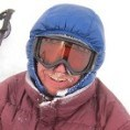 man wearing snow goggles and a smile