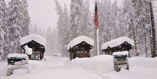 snow covered entrance station, road not plowed