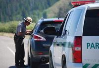 park ranger talks to driver