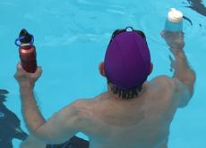 holding water bottles in pool