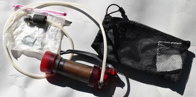 water purifying pump and zip lock bag