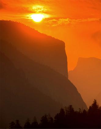 brilliant globe of sun with El Capitan and Half Dome