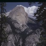 half dome with clouds behind