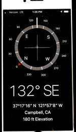 cell phone showing compass, latitude, longitude, elevation