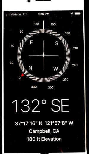 cell phone showing compass, latitude, longitude, elevation