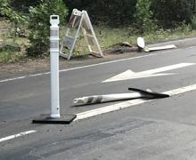 smashed pylons on road